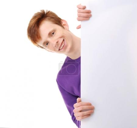 Teenager with blank poster