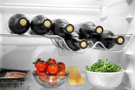 Wine bottles and vegetables