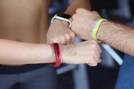 Hands with fitness trackers