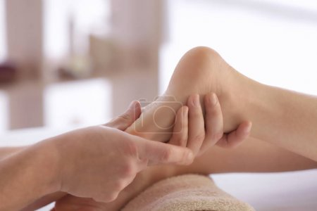 young woman receiving foot massage