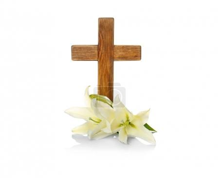 Wooden cross and lily