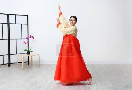 woman in Korean traditional costume dancing