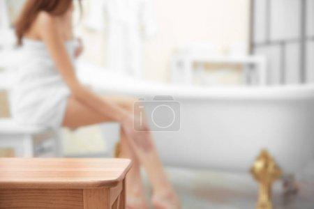 Wooden stool in bathroom
