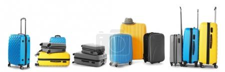 Set of suitcases on white