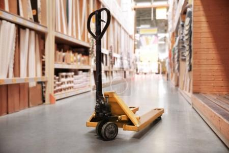 Photo for Modern Manual pallet jack in supermarket - Royalty Free Image