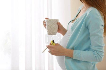 Pregnant woman smoking cigarette