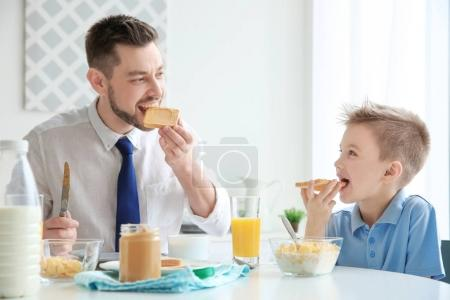 Dad and son having lunch