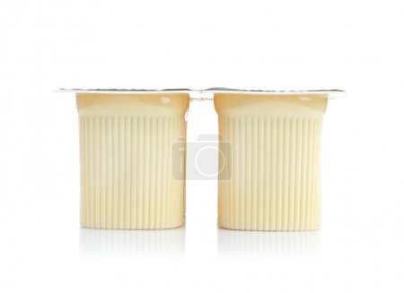 Plastic cups with yogurt