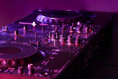 Dj mixer in nightclub