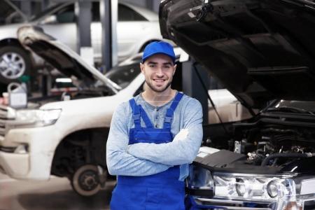 Young mechanic in blue cap