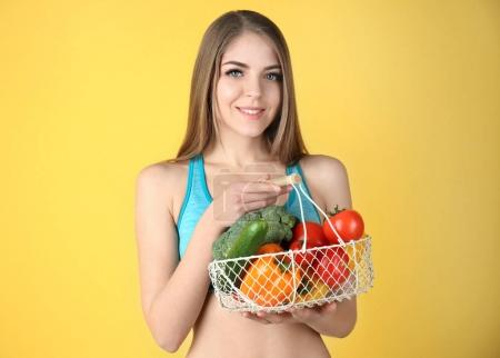 Young beautiful woman holding basket