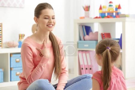 girl at speech therapist office