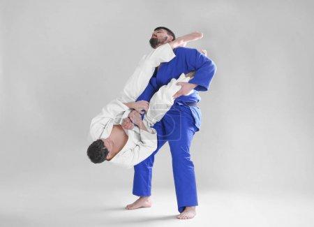Men practicing martial arts