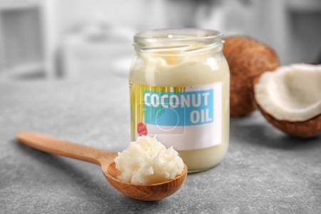 Spoon and jar with coconut oil