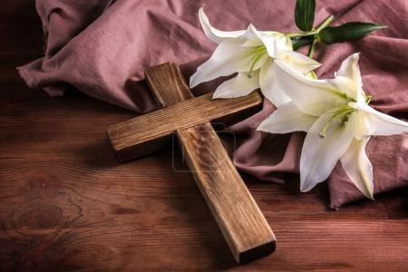 Wooden cross and white lily