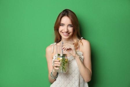 Photo for Beautiful young woman with lemonade on color background - Royalty Free Image