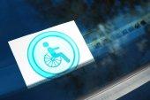 Symbol of handicapped on car