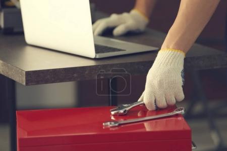 mechanic selecting tool