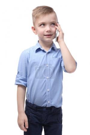 Cute little boy talking by mobile phone