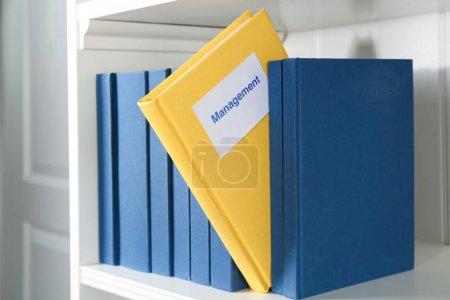 Book of MANAGEMENT on shelf