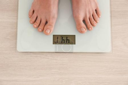 emale bare feet standing on scales