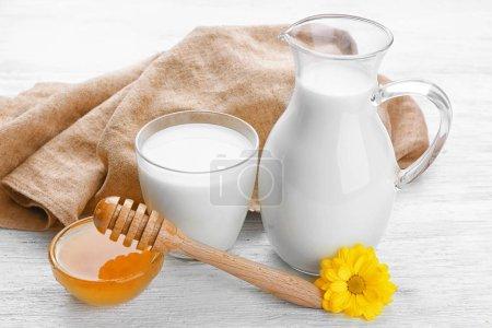 Jar of milk with delicious honey