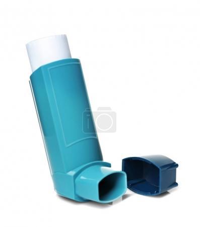 Asthma inhaler on white