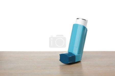 Asthma inhaler on table