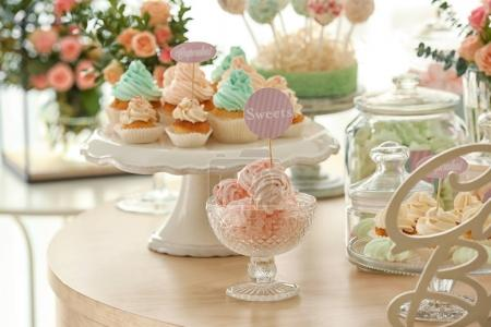 Table with tasty sweets