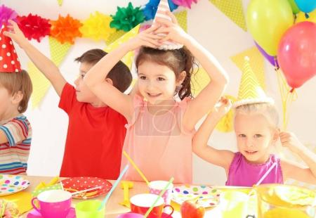 Cute little children celebrating birthday at party