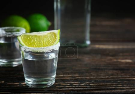 Tequila shot with lime slice