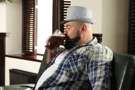 Bearded man drinking beer