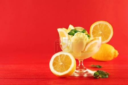 Tasty lemon ice cream in bowl