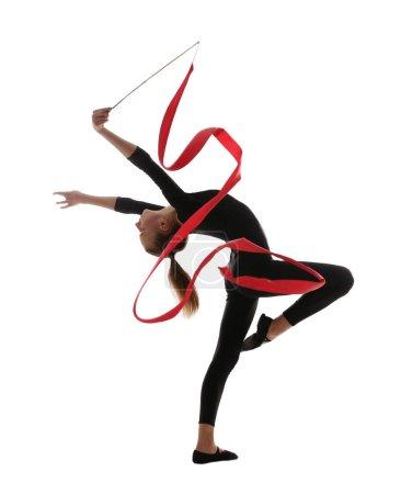 Young girl doing gymnastics with ribbon