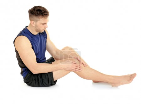 young man suffering from pain in leg