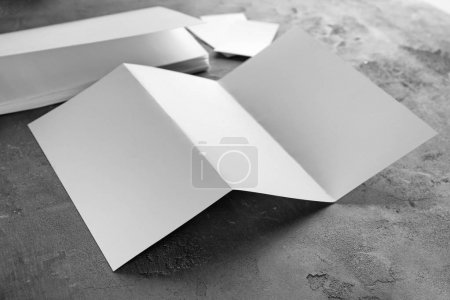 Blank brochure on gray surface