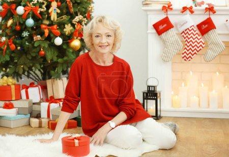 Elderly woman in living room