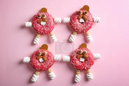 Photo for Funny decorated donuts on table - Royalty Free Image