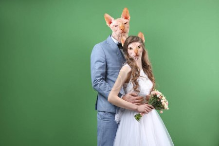 couple with heads of cats