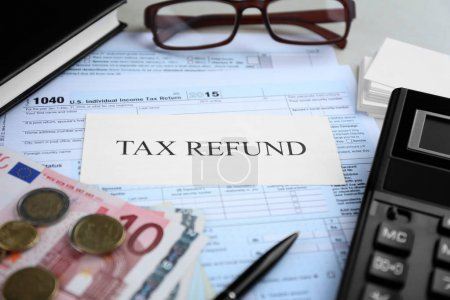 Paper sheet with text TAX REFUND