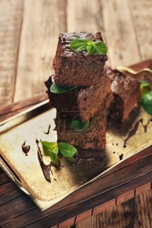 Metal tray with delicious cocoa brownies on wooden...