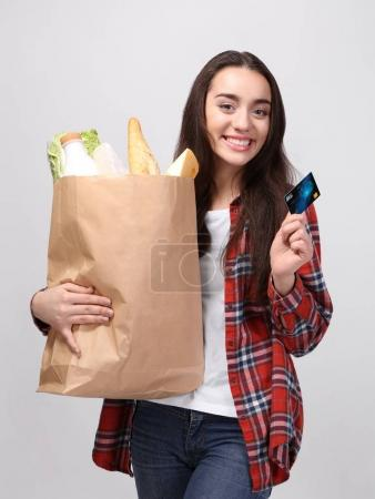 woman with paper bag of products