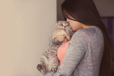 Beautiful young woman with cute cat