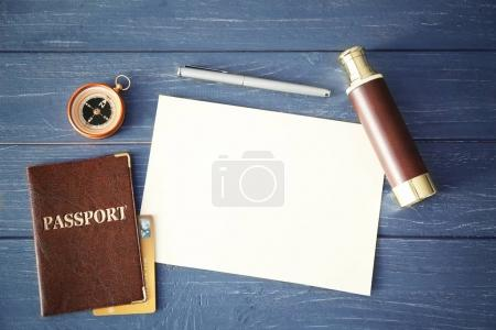 Passport, compass and spyglass
