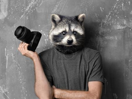 Photographer with head of racoon