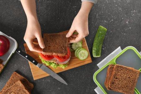 Mother preparing sandwich