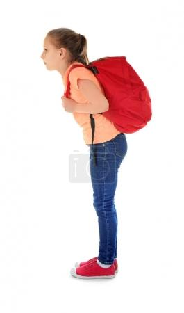 Cute schoolgirl with backpack on white background