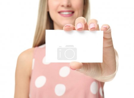 Photo for Beautiful young woman with business card on white background, closeup - Royalty Free Image