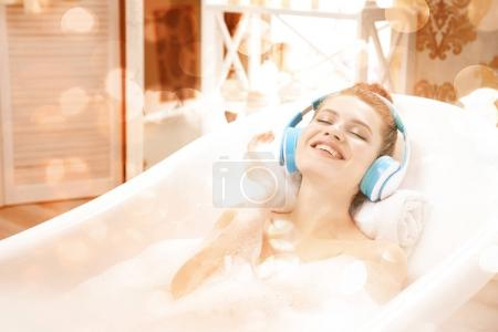 attractive woman relaxing in bath