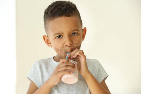 African boy drinking yogurt